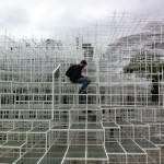 An image showing someone sitting half way up the Serpentine Pavilion