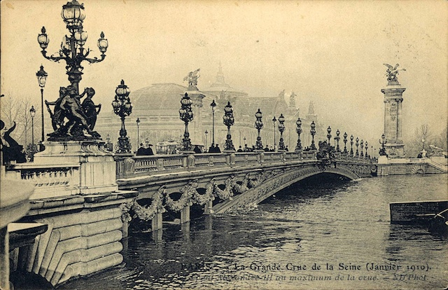 Sepia image showing the waters of the Seine at record height under the Pont Alexandre III in Paris.