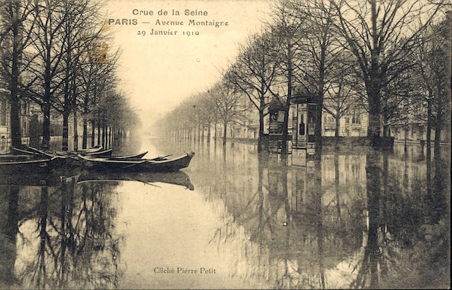Image showing the Avenue Montaigne in Paris flooded with some boats moored in the middle distance.