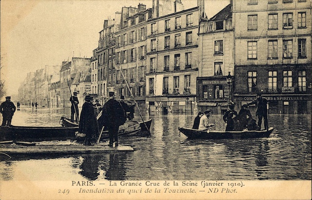 Image showing people being punted along flooded streets in Paris.