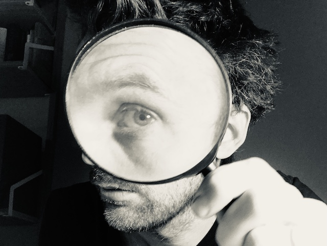 Looking through a magnifying glass to illustrate the concept of real-world search